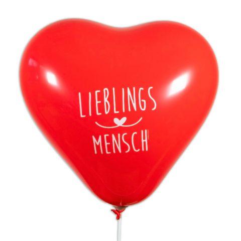 """Großer, roter Herzballons mit weißem Aufdruck """"Lieblingsmensch""""."""