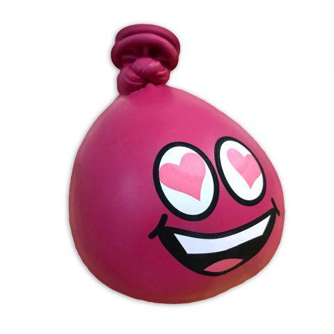 Pinker Anti-Stress-Ballo aus Luftballons mit einem lachenden Gesicht und Herzchen in den Augen.
