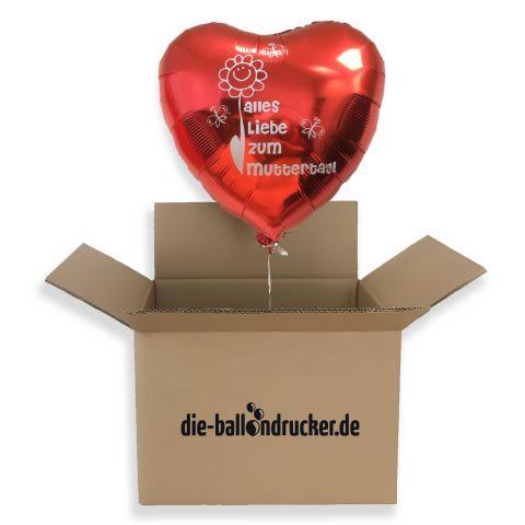 """Roter Folienballon mit Aufdruck """"Alles Liebe zum Muttertag"""" der aus Karton schwebt"""