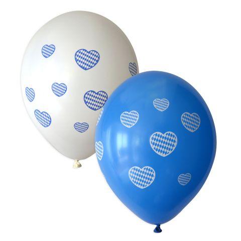 weißer Luftballon mit vielen kleinen blauen Herzen, gefüllt mit Rauten. Und blaue Ballons mit weißen Herzen, gefüllt mit Rauten.