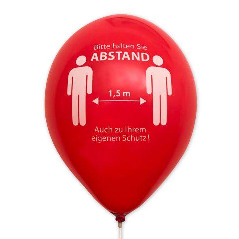 """roter Luftballon mit Corona-Hinweis """"Bitte Abstand halten in weiß"""