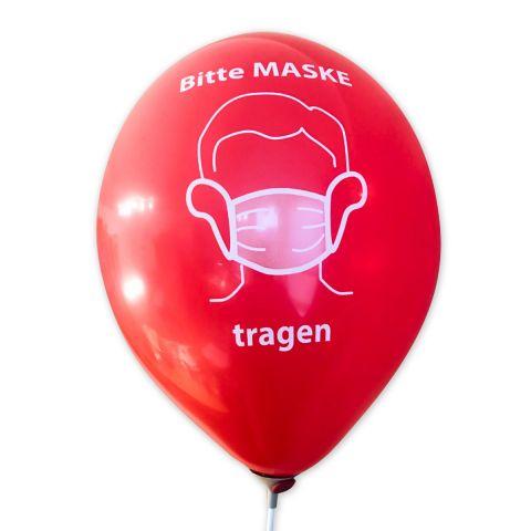 """Roter Luftballon mit Aufdruck Corona-Hinweis """"Bitte Maske tragen"""" in weiß"""