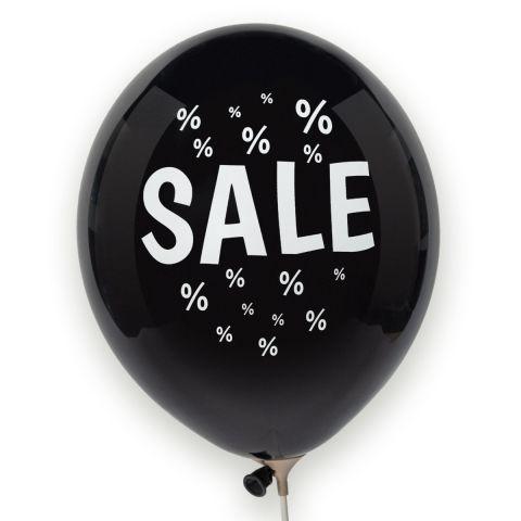 """Schwarzer Luftballon mit weißem Aufdruck """"SALE"""" und vielen kleinen, weißen Prozentzeichen drumherum."""
